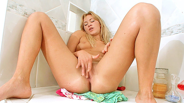Tight blonde masturbates in the shower